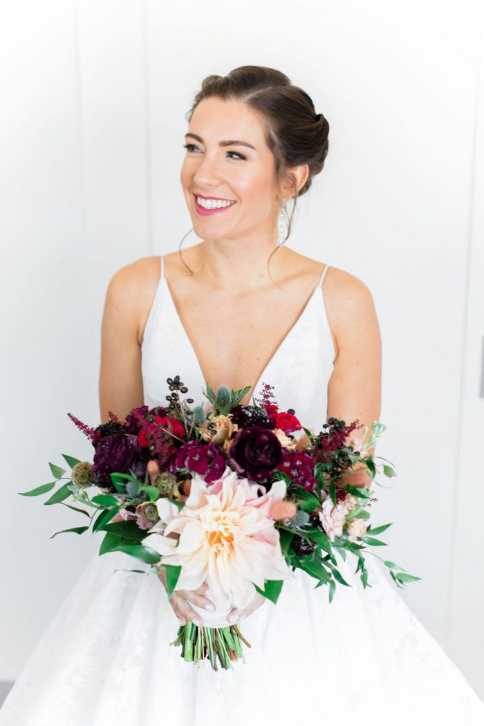 Bridal Portrait holding wedding bouquet with burgundy and blush flowers
