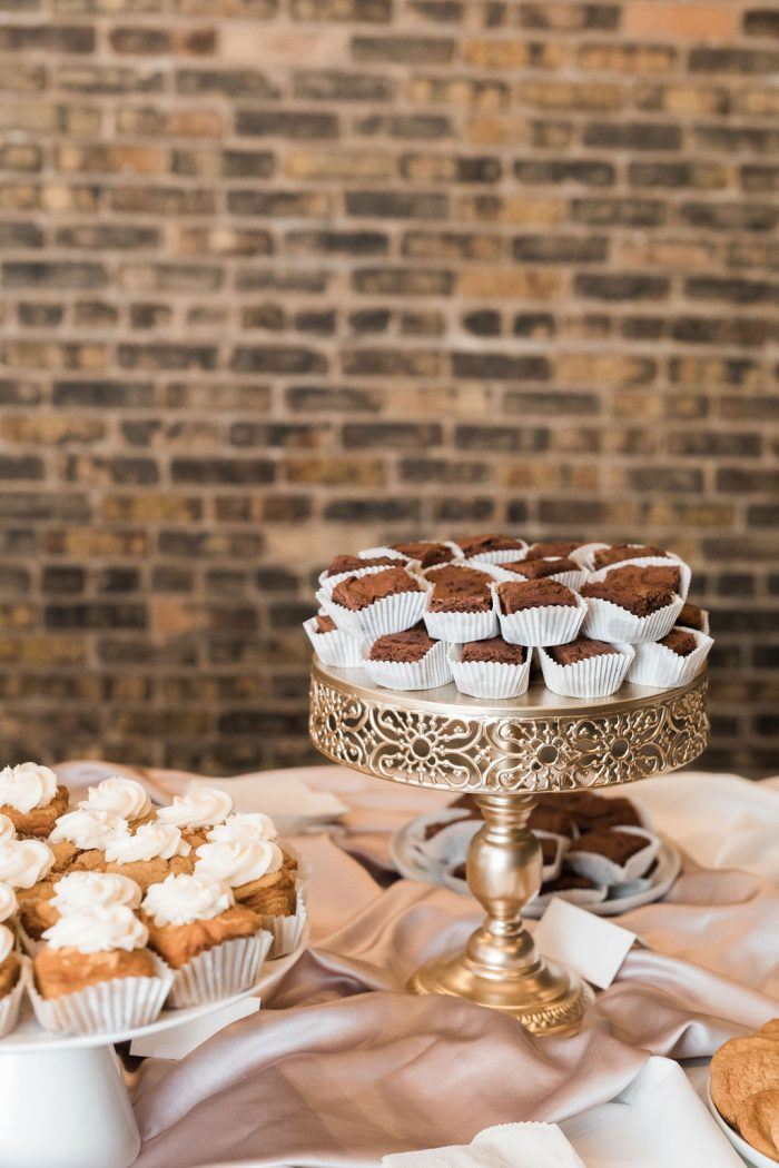 Wedding Desserts displayed in front of exposed brick wall