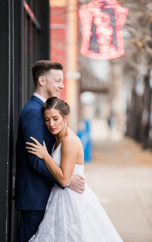 Bride resting her head on her smiling groom's shoulder