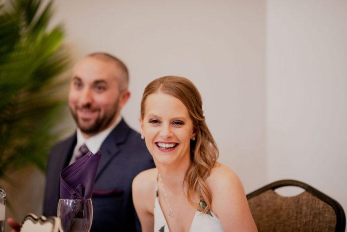 Bride smiling at the head table