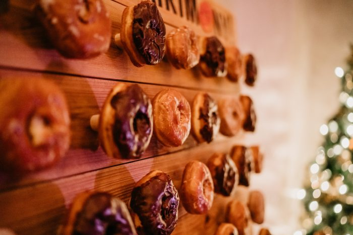 Glazed and frosted donuts on donut wall