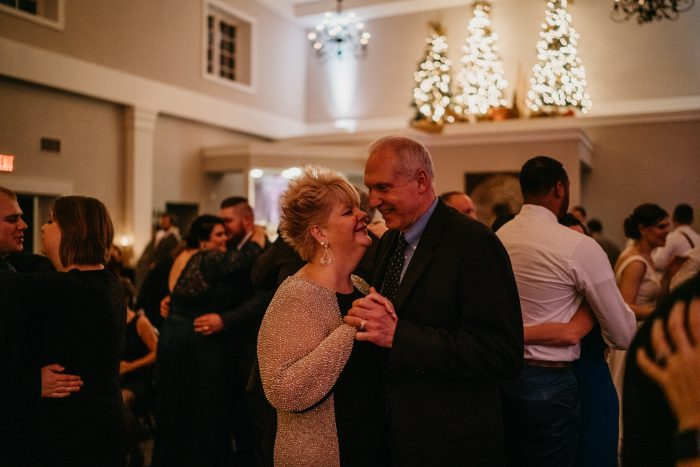 Wedding Guests slow dancing with glowing holiday trees