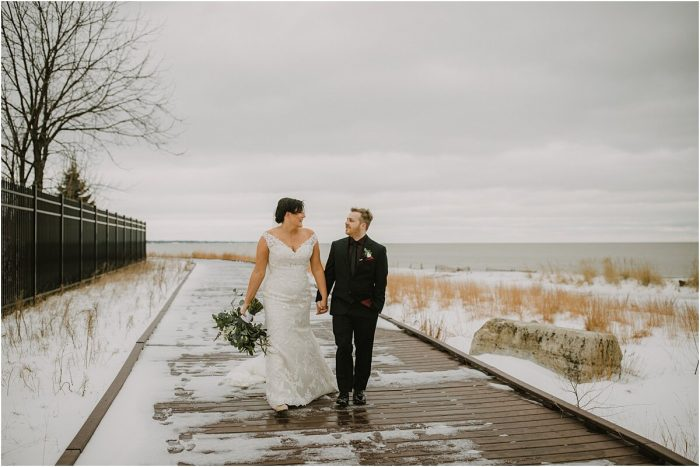 Bride and Groom walking down the pier along Lake Michigan