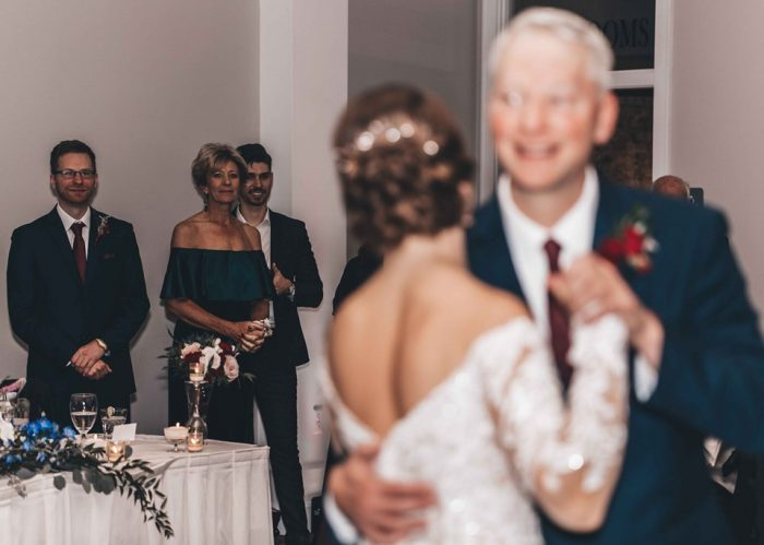 Bride dancing with her Father-in-law in front of her mother and wedding guests