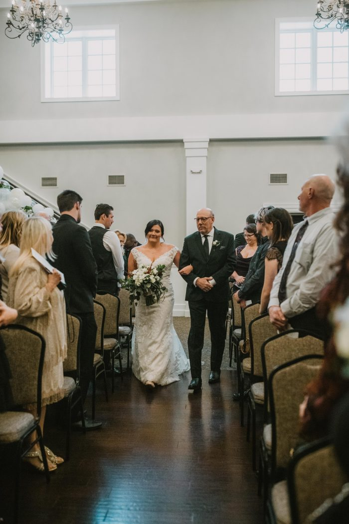 Bride and Dad walking down the aisle to ceremony