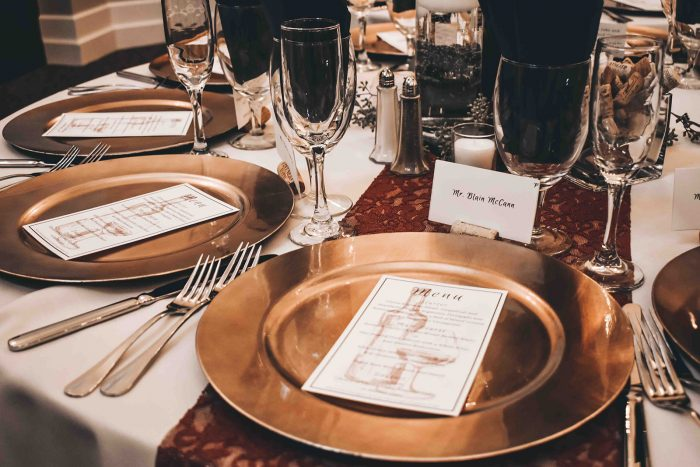 Wedding Place Setting with Gold Charger, Menu Card, Wine Cork Place Card, and Burgundy Lace Table Runner