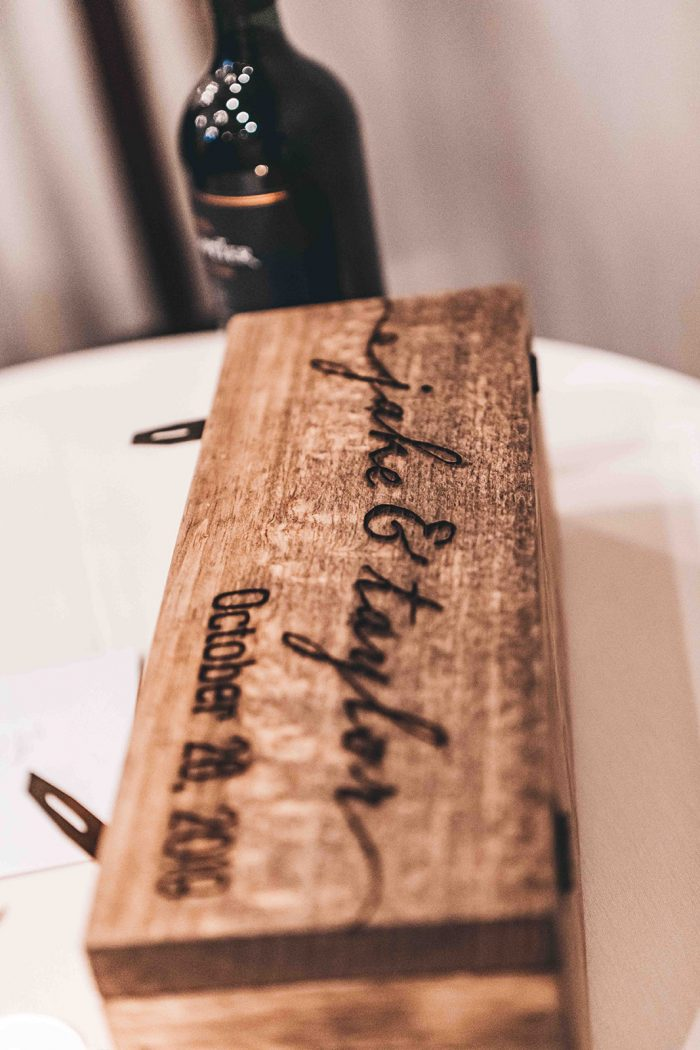 Bride and Grooms names engraved onto the lid of a wooden wine box