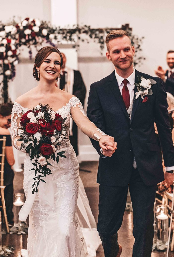 Bride and Groom smiling as they recess down the aisle from their ceremony