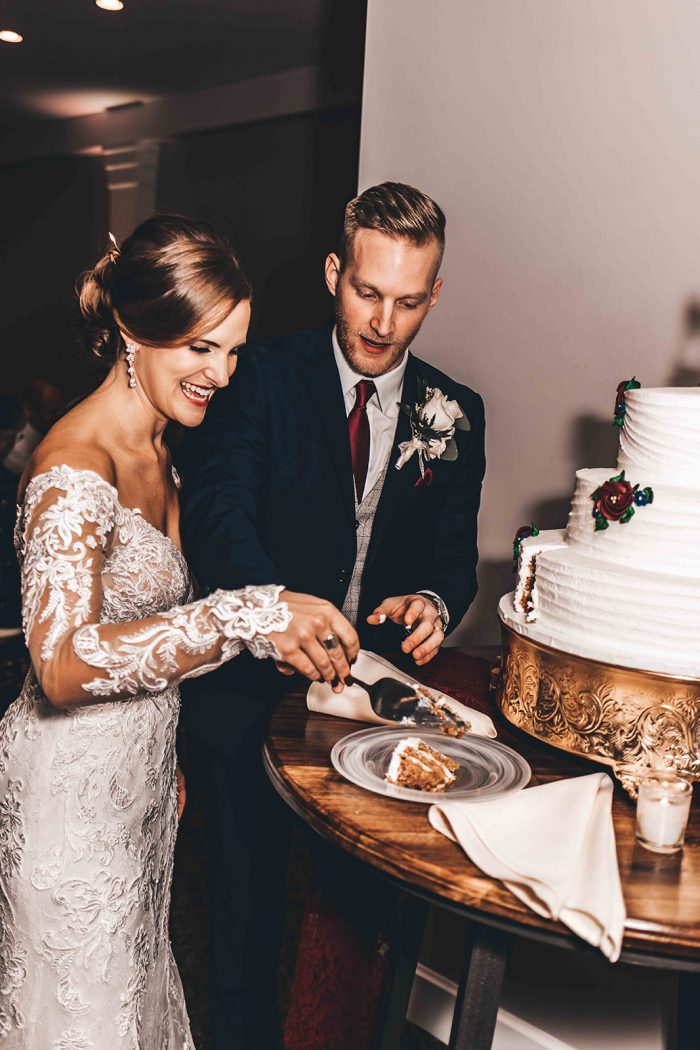 Bride and Groom smiling as the cut their wedding cake